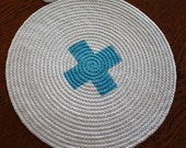Handmade Rope placemat or trivet. Turquoise trim.