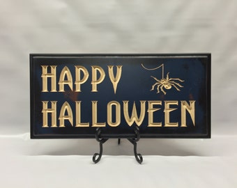 "Carved ""Happy Halloween"" sign"