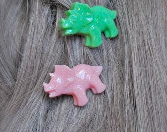 pair of sparkly pastel kawaii triceratops dinosaur hair clips