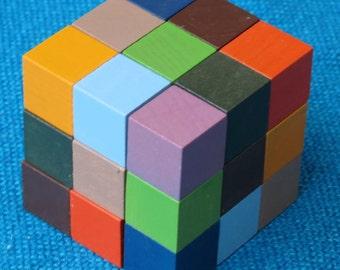 Nonahuebes or Nine Colour Puzzle, 2cm coloured wooden cubes.