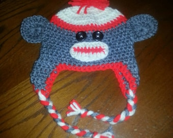 Crocheted sock monkey hats