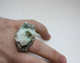 Silver ring with an aquamarine rough