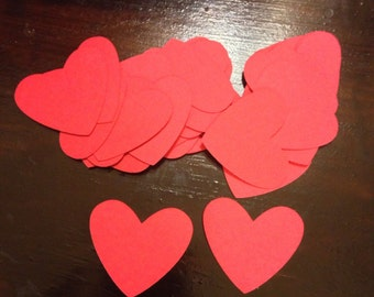Set of 35 small red die cut hearts