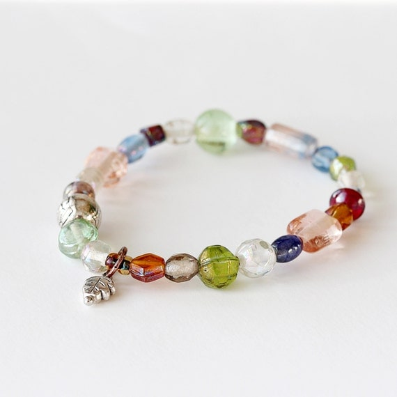 pastel multi colored glass beaded bracelet antiqued by