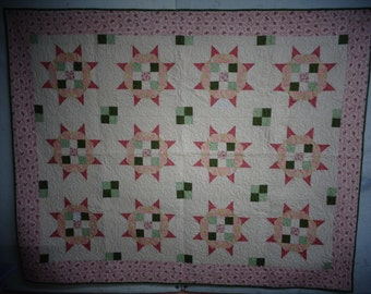 Starfire pattern in greens and pinks with tiny pink roses