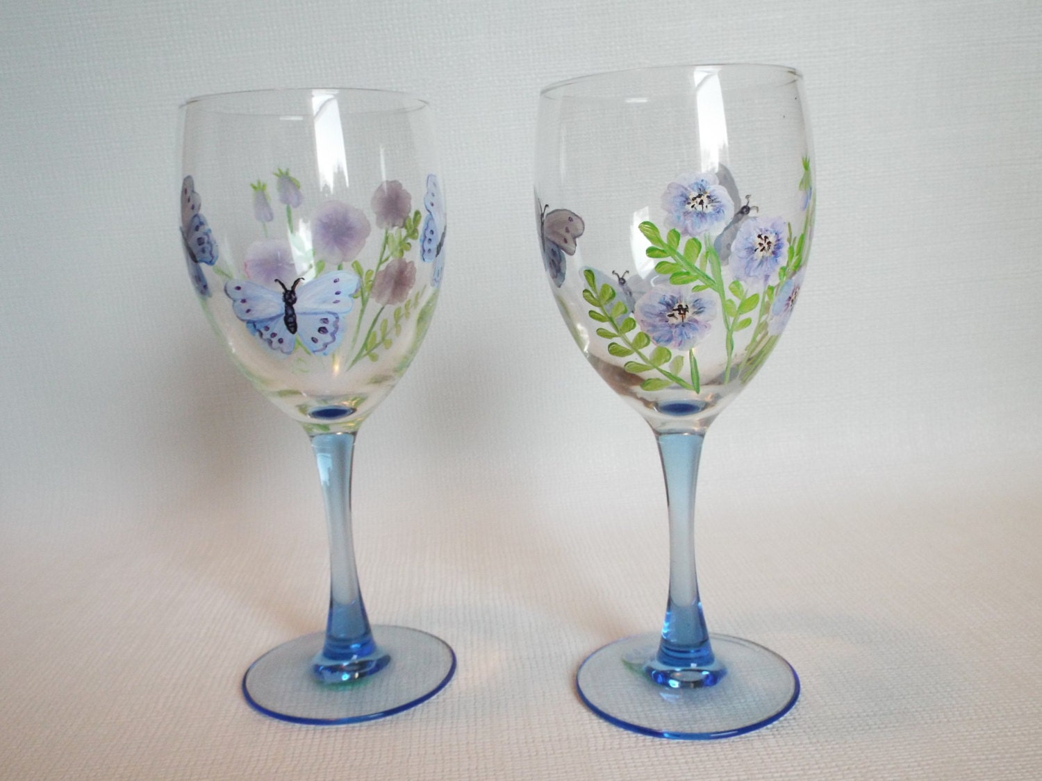 Hand painted wine glass set with blue flowers and butterflies for Hand painted wine glasses