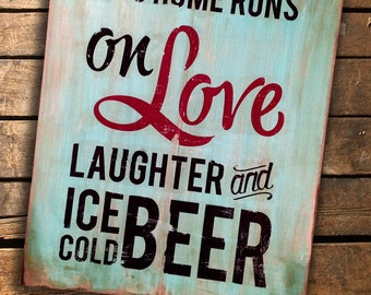 """This Home Runs on Love, Laughter and Ice Cold Beer...wooden sign measures 18"""" x 22"""""""