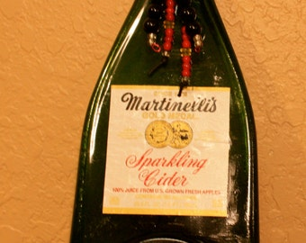 Non-alcohol Martinelli's Sparkling Cider bottle with black rope,red wire and beadwork.
