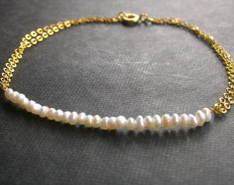 Tender arm bracelet with freshwater pearls