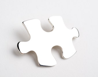 Steling silver puzzle brooch.