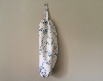 Blue & white flower carrier bag holder.