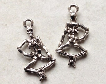 Bulk Lot 20 silvertone dancing skeleton charms 25x13mm small Day of the Dead / Halloween trinkets  #68a