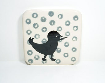 tile with a black bird on some stormy grey dots, made to order / pick your colour