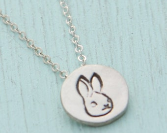 tiny silver BUNNY necklace, illustration by BOYGIRLPARTY , eco-friendly silver.  Handcrafted by Chocolate and Steel.