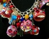Frida Kahlo Day of The Dead Charm Necklace - 9 large hand carved porcelain skulls by Leandra Holder