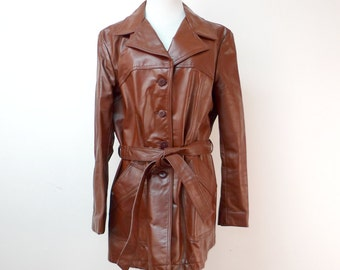 OFF to BALTIMORE . leather jacket . size 18 . made in USA