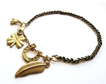 Black thread and frosted gold plated chain bracelet w horseshoe, feather, bee & four leaf clover charms. Lucky, boho, hippie, gift under 10.