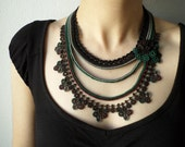 Beaded crochet statement necklace with black, maroon, green, gray seed beads and crocheted flowers
