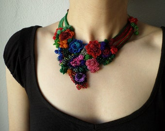 colorful freeform crochet bib necklace -  statement necklace with red, purple, pink, blue, gray and green beaded crochet flowers