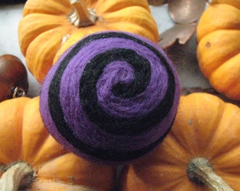 One multi-colored felted pin-cushion, Purple and Black