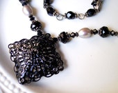 Penny Dreadful Pearl Necklace with a Vintage Victorian Style Medallion and Jet Crystal