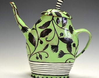 Green Teapot With Black Flowers and Stripes.