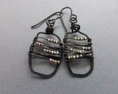 Hammered, wire wrapped dark metal with tan beads earrings