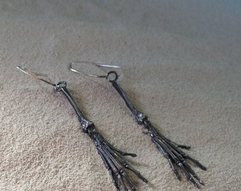 death's hands earrings