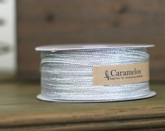 Bulk 100 yard roll of Narrow Metallic Silver Ribbon 1/8""