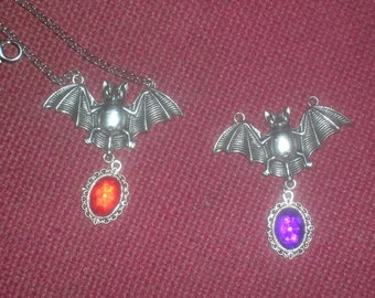 vampire bat with crystal pendant