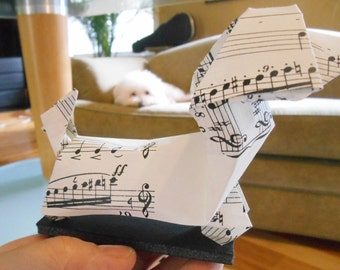 Two large musical origami penguins and two large musical origami dogs for MISSFLORE