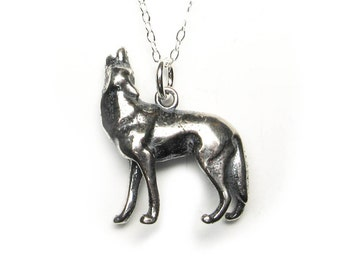 Solid sterling silver howling wolf pendant or charm, with antique patina. Canine. Dog.
