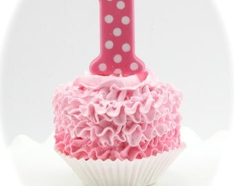 First Birthday Fake Cupcake. Two-Toned Ruffle Standard Cupcake. Your Choice Color. Pink or Blue Polka Dot Candle. 12 Legs Signature Design.