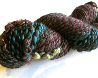 136 yds, bulky handspun yarn, 2 ply with wrapped locks, 'Trapped No. 2'