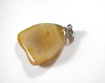 Pendant, handmade of a Baltic amber. EK146