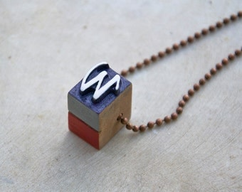 Vintage wooden typographic necklace. Antique copper chain. Letter W white grey dark-red wood