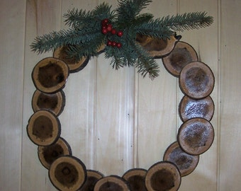 box elder tree wood sliced log rounds  wreath with pine bough and berries