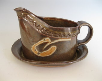 Gravy boat with attached tray