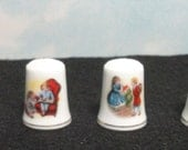 Vintage Avon Christmas Thimbles. Set of 4. From 1981 to 1984