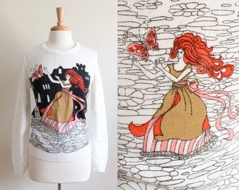 1960s Sweater / Vintage Mainliner Fairy Tale Print White Sweater