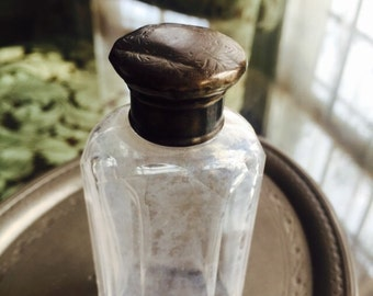 Old perfume bottle with sterling cap