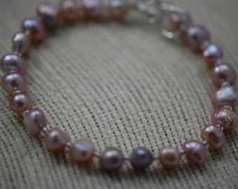 Iridescent pink & purple fresh water pearl bracelet. Handmade, beaded, fresh water pearl bracelet, toggle clasp, wedding jewelry, bridal.