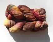 Hand dyed brown, peach, yellow, red, teal merino, bamboo, nylon sock yarn