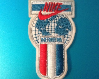 Vintage Nike International Patch. 3 1/8 inch. Embroidered Cloth Original. Red, White and Blue.