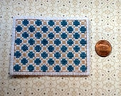 Handstitched dollhouse rug in beige and teal