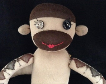 Brown and Tan Argyle Sock Monkey with button eyes and a kiss mouth