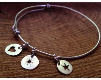 Sterling silver bangle bracelet with charms.