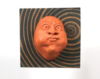 """Wall Sculpture, Funny Gift Ideas, Humorous Art, Theatre Mask, Unique Wall Art, Cement Face """"Burst"""" with End-Grain Board, Made in Portland"""