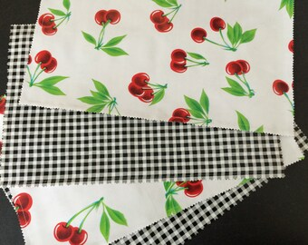 Reversible oilcloth placemats in a retro cherries on white