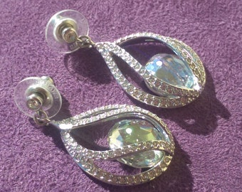 Authentic Swarovski Megan Pierced Earrings in new condition, super sparkly